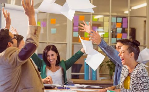 46068877 - group of business people celebrating by throwing their business papers in the air