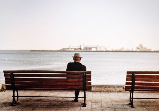 retiree alone on a bench
